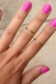 Image of on the tip    above the knuckle/midi ring