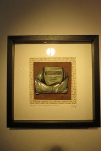"Image of ""They have a shield Nothing must be revealed"" hand painted can framed"