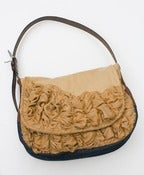 Image of a large tough ruffles shoulder bag in toasted almond and amber
