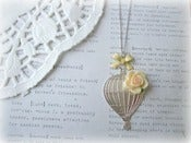 Image of Silver Hot Air Balloon Necklace with Yellow Flower