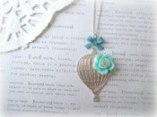 Image of Silver Hot Air Balloon Necklace with Blue Flower