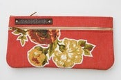 Image of double zip clutch in tomato with vintage floral appliques (a)