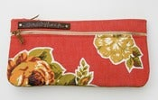 Image of double zip clutch in tomato with vintage floral appliques (b)