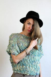 Image of welland merino wool sweater (shown in carnival )