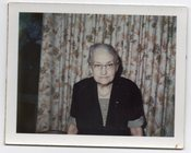 Image of INTENSE OLD WOMAN BARKCLOTH DRAPES VINTAGE COLOR POLAROID PHOTO
