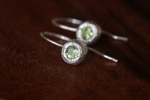 Image of silver bud earrings with peridot