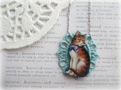 Image of Pussy Cat with Blue Ribbon in Blue Frame Necklace