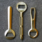 Image of cast brass bottle openers