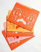 Image of Face Folder 3 pack-- pink, orange, yellow.