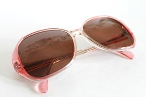 Image of 1970's vintage sunglasses. Never Worn.