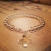"Image of ""Trust"" Sterling Silver Cross Charm Bracelet"