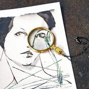 Image of brass magnifying lens necklace