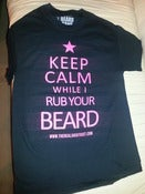 Image of LADIES KEEP CALM WHILE I RUB YOUR BEARD TSHIRT BLACK WITH PINK PRINT