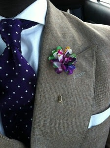 Image of purple floral lapel flower (fl)