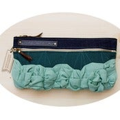 Image of tough ruffles double zip clutch in sea glass