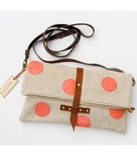 Image of foldover crossbody bag with hand cut leather dots (coral)