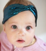 Image of tiny metallic blue and black turban