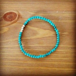 Image of turquoise and gold bead bracelet