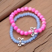Image of mrd arm candy- blue/pink silver bow bracelet