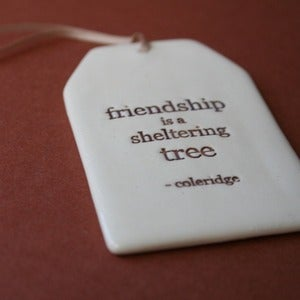 Image of ceramic quote tag - sheltering tree