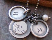 Image of soar wtih 2 rimmed initial charms