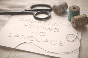 "Image of Hand-stitched 5x7 Quote: ""Creativity Knows No Language"""