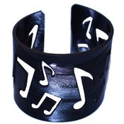 Image of Music Note Bracelets cut out of recycled BLACK and RED vinyl records.