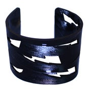 Image of Lightning Bolt Bracelets cut out of recycled BLACK and RED vinyl records.