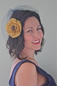 Image of Bianca - Navy Birdcage Veil paired with Golden Silk Flower with Vintage Brooch Center