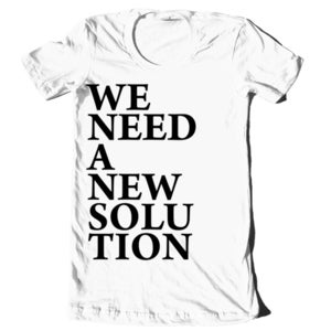 Image of &quot;We Need A New Solution&quot; Block Letters Shirt