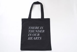 Image of thunder in our hearts tote in black 