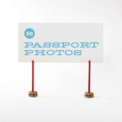 Image of passport photos sign