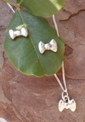 Image of bow earrings and matching pendant