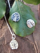 Image of ladybug earrings and matching pendant