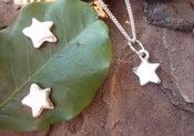 Image of star earrings and matching pendant