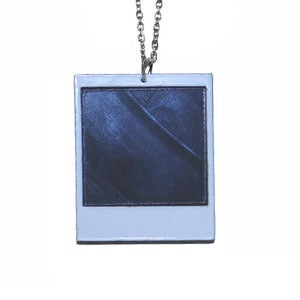 Image of Ltd. Edition Instant Film Necklace made from recycled vinyl records.