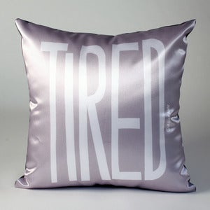 Image of TIRED Pillow (white on gray)