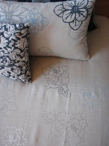 Image of stitched peony bed linen