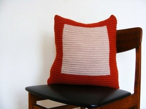 Image of Hand Knit Cushion 45 x 45cm - Hermes orange colourblock