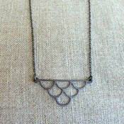 Image of 3-zinn - oxidized silver