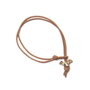 Image of 14k gold single vertebrae on natural leather bracelet (B0114k)
