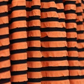 "Image of NEW - ""Trick or Treat"" Black and Orange Striped Ruffle"