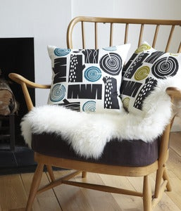Image of Logpile cushion in black on white linen