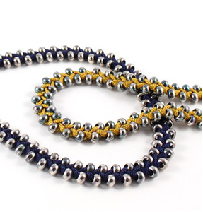 Image of long beaded plait necklace- mustard