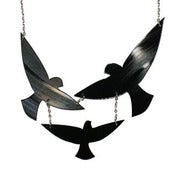 Image of Birds In Flight Necklace made from a recycled vinyl record.