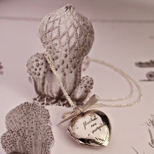 Image of heart locket with hand engraving