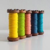 Image of Coloured Paper Twine On Vintage Wooden Bobbin