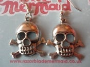 Image of Wide Eyed Skull and Crossbone Silvertone Earrings