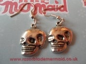 Image of Smiling Skull Shiny Silvertone Earrings