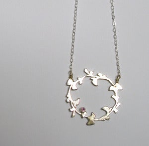 Image of circular gingko necklace with birthstone